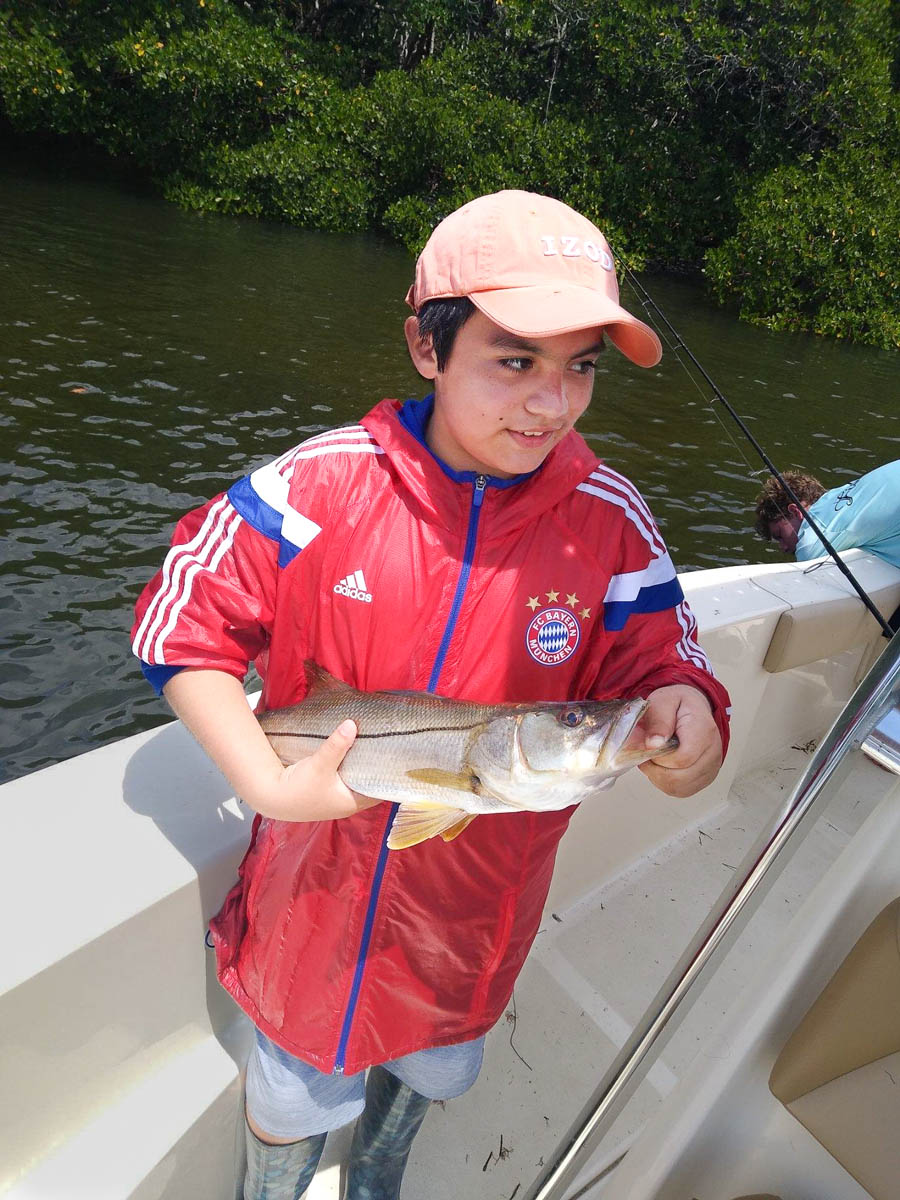Child showing his catch on a Fish Huge Charter