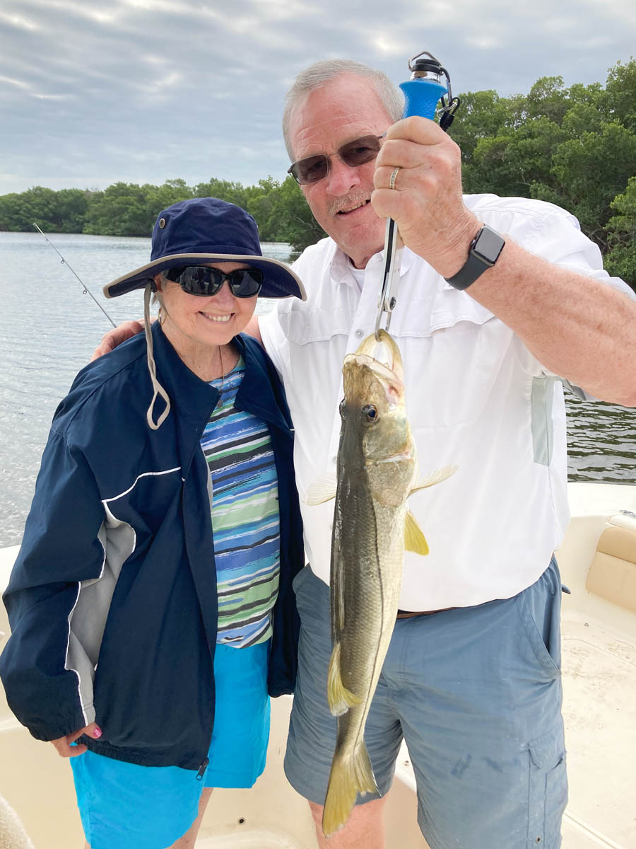 Couple showing their catch on a Fish Huge Charter in Tampa Bay